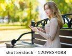 young beautiful woman walks... | Shutterstock . vector #1209834088
