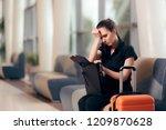 forgetful girl checking her bag ... | Shutterstock . vector #1209870628