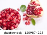 blood red pomegranate | Shutterstock . vector #1209874225