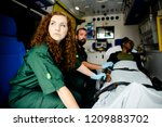 paramedics with a patient in an ...   Shutterstock . vector #1209883702