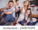 playful family celebrating... | Shutterstock . vector #1209973495