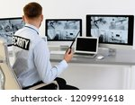 male security guard with... | Shutterstock . vector #1209991618