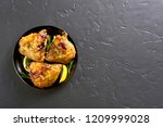 grilled chicken thighs on plate ...   Shutterstock . vector #1209999028