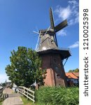 windmill in burdaard friesland... | Shutterstock . vector #1210025398