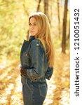 blonde woman in blue denim... | Shutterstock . vector #1210051432