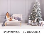 happy young woman opening gift... | Shutterstock . vector #1210090015