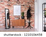 wooden cupboard with plant on... | Shutterstock . vector #1210106458