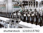 glass bottles on the automatic... | Shutterstock . vector #1210115782