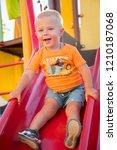 the little boy in an orange t... | Shutterstock . vector #1210187068