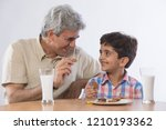 grandfather and grandson eating ... | Shutterstock . vector #1210193362
