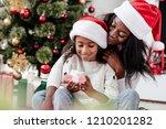 happy african american woman... | Shutterstock . vector #1210201282