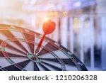 Stock photo red dart stick on dartboard close up shot red dart arrow on center of dartboard with transportation 1210206328