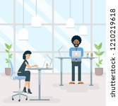 two office employees work on... | Shutterstock .eps vector #1210219618