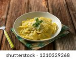 ravioli stuffed with spinach... | Shutterstock . vector #1210329268