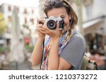 young woman taking photographs... | Shutterstock . vector #1210373272