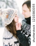 love story in the winter forest.... | Shutterstock . vector #1210383355