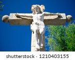 stone statue sculpture of jesus ... | Shutterstock . vector #1210403155