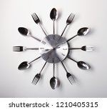 clock design with spoons and... | Shutterstock . vector #1210405315