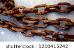 chains with rust on the cement... | Shutterstock . vector #1210415242