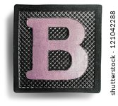 photograph of game tile letter b