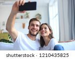 young couple taking a selfie on ... | Shutterstock . vector #1210435825
