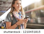 young woman waiting for a train ... | Shutterstock . vector #1210451815