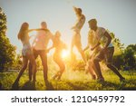 group of happy friends playing... | Shutterstock . vector #1210459792