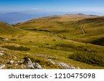 green mountain grass field ... | Shutterstock . vector #1210475098