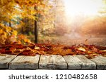 autumnal leaves on a wooden... | Shutterstock . vector #1210482658