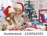 portrait of happy grandmother... | Shutterstock . vector #1210563352
