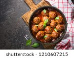 Meatballs In Tomato Sauce In A...