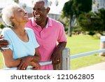 senior couple walking in park... | Shutterstock . vector #121062805