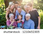 summertime  a family with three ... | Shutterstock . vector #1210652305
