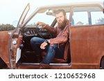 bearded male dressed in brown... | Shutterstock . vector #1210652968