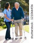 carer helping senior man with... | Shutterstock . vector #121066456