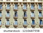 beautiful balconies adorn a... | Shutterstock . vector #1210687558
