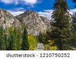 driving through the sierra... | Shutterstock . vector #1210750252