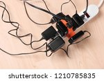 wall chargers plugged in gang... | Shutterstock . vector #1210785835