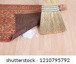 sweeping dirt under a rug | Shutterstock . vector #1210795792