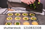 Stock photo step by step filling metal muffin pan with cornbread batter to bake spicy jalapeno cornbread 1210832338