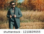 a handsome man in countryside....   Shutterstock . vector #1210839055