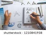 graphic designer drawing sketch ... | Shutterstock . vector #1210841938