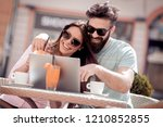 young couple drinking a coffee... | Shutterstock . vector #1210852855