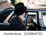 hotel doorman opens luxury car... | Shutterstock . vector #1210864732