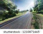 the highway is in the green... | Shutterstock . vector #1210871665