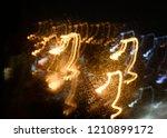 abstract lights at night fire... | Shutterstock . vector #1210899172