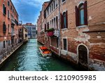venice  italy. tight canals... | Shutterstock . vector #1210905985