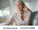 senior woman working on... | Shutterstock . vector #1210951888