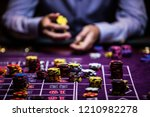 casino player with chips | Shutterstock . vector #1210982278