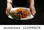 shrimps pad thai in paper... | Shutterstock . vector #1210990078